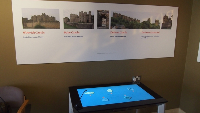 A table running the app beneath one of the exhibit's display