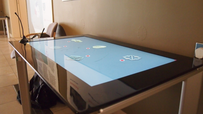 The app running on an interactive table at Bede's World